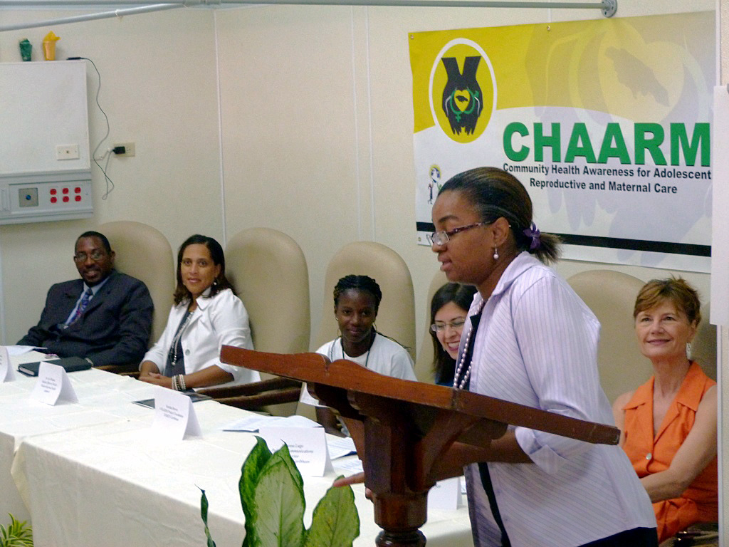 Western Regional Health Authority Medical Officer Dr. Lisa Wisdom shares her perspectives on the importance of the program for Trelawny's youth, while other speakers and dignitaries look on. From left are Trelawny Mayor Garth Wilkinson, Senior Education Officer Allison Cooke-Hawthorne, CHAARM Project Coordinator Venisha Brown, MSD Policy and Communications Director Vanessa Lugo, Dr. Wisdom, and INMED President and CEO Dr. Linda Pfeiffer.
